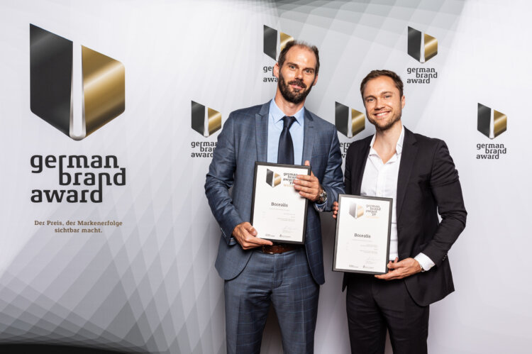 "photo: Borealis wins twice in category ""Excellence in Brand Strategy & Creation"". Borealis Head of Communications (ad interim) Andreas Hummel & Max Riedel, Interbrand received the renowned awards in Berlin."