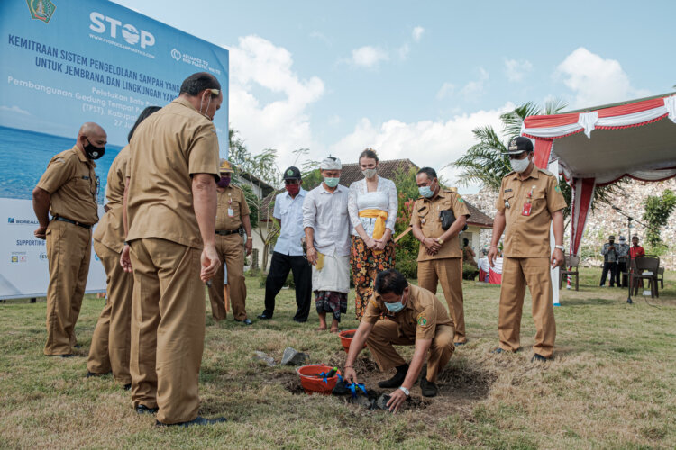 Photo: Taking the first steps towards eliminating plastic leakage into the environment,  I Nengah Ledang; Assitant I for Governance Divison, Jembrana's Regency lay the cornerstone of a material recovery and recycling facility in Jembrana, Bali.